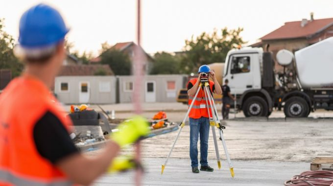 Surveyors On Construction Site